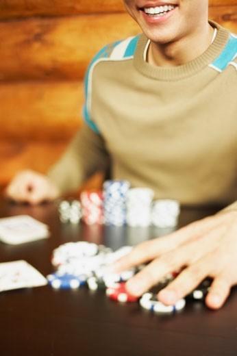 Stock Photo: 1555R-309606 Man playing poker