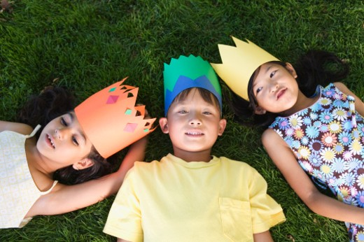 Stock Photo: 1555R-309655 High angle view of children lying on grass