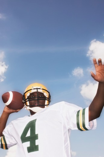 Stock Photo: 1555R-309948 Football player throwing football