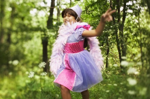 Stock Photo: 1555R-309985 Running pre-teen girl wearing princess costume