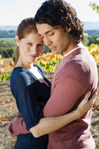 Stock Photo: 1555R-310485 Couple embracing at vineyard