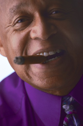 Stock Photo: 1555R-31052 Man smoking cigar