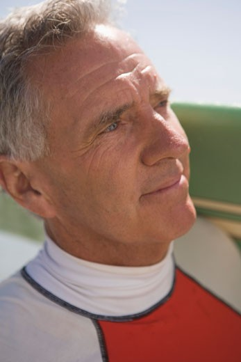 Close-up of middle-aged man with surfboard : Stock Photo