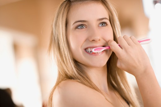 Stock Photo: 1555R-311608 Teenage girl brushing teeth