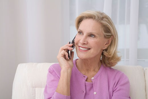 Stock Photo: 1555R-311708 Senior woman using cell phone