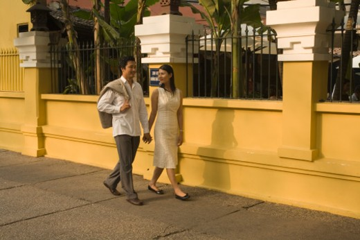 Stock Photo: 1555R-312643 Couple holding hands and walking