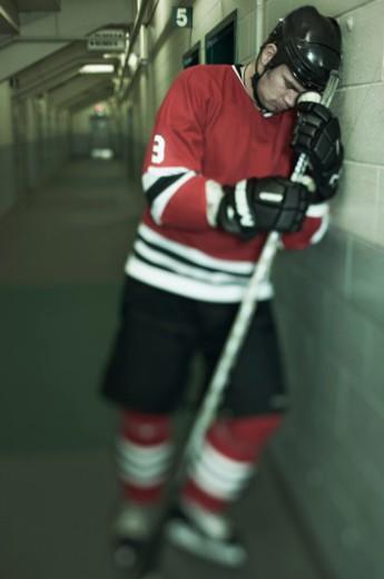 Sad ice hockey player : Stock Photo