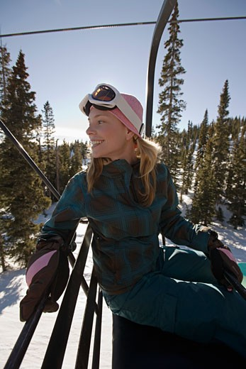 Woman looking back on chairlift : Stock Photo