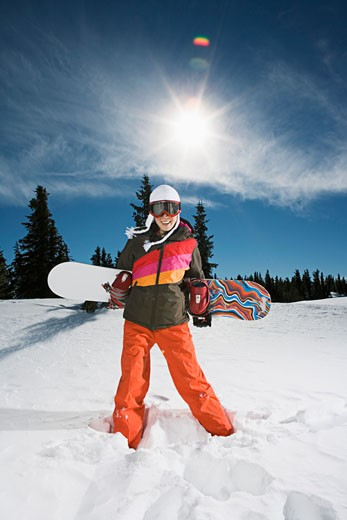 Snowboarder posing on sunny winter day : Stock Photo