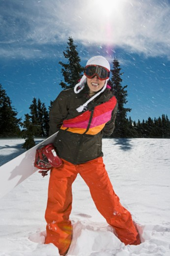 Woman with snowboard : Stock Photo