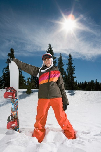 Stock Photo: 1555R-314043 Woman posing with snowboard
