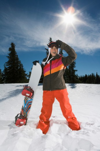 Woman posing with snowboard : Stock Photo