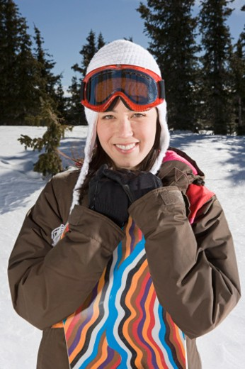 Stock Photo: 1555R-314048 Portrait of snowboarder