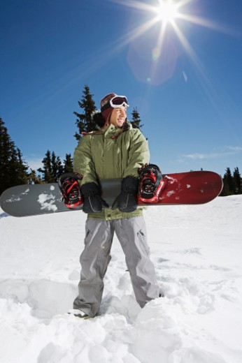 Stock Photo: 1555R-314053 Man holding snowboard
