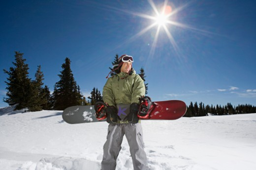 Man holding snowboard : Stock Photo
