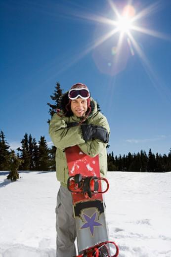 Man posing with snowboard : Stock Photo