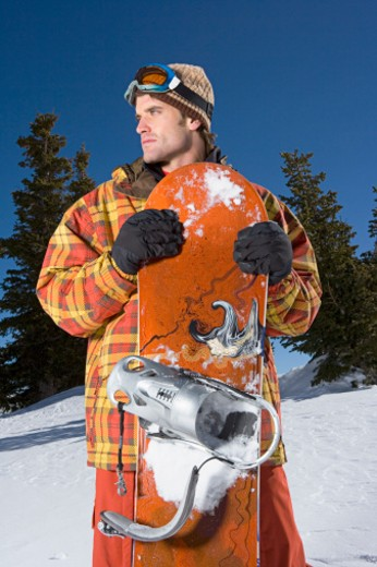 Stock Photo: 1555R-314057 Portrait of man with snowboard