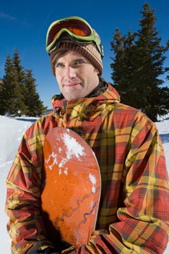 Portrait of man with snowboard : Stock Photo