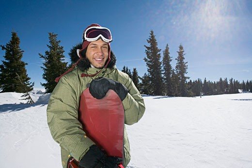 Snowboarder on sunny winter day : Stock Photo