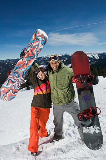 Excited snowboarding couple : Stock Photo