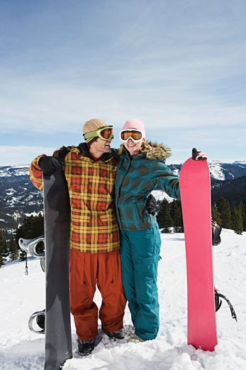 Stock Photo: 1555R-314082 Couple snowboarding together