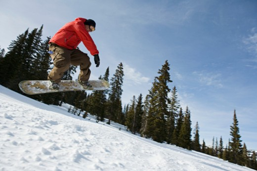 Stock Photo: 1555R-314087 Snowboarder in midair