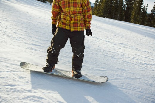 Stock Photo: 1555R-314091 Man on snowboard