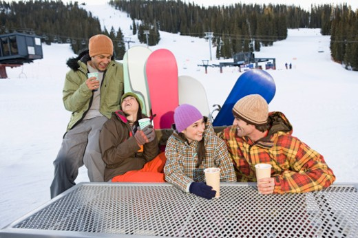 Stock Photo: 1555R-314093 Snowboarders taking a break