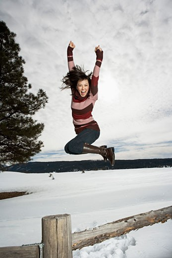 Stock Photo: 1555R-314110 Leaping woman in midair