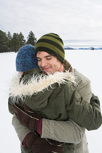 Stock Photo: 1555R-314116 Embracing couple in winter attire
