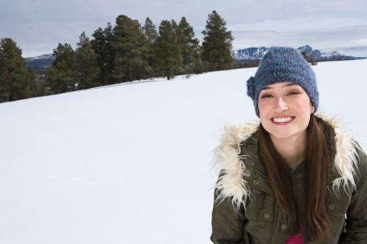 Smiling woman in winter attire : Stock Photo