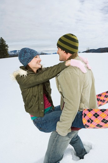 Playful couple in winter attire : Stock Photo