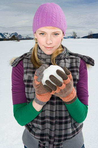 Stock Photo: 1555R-314134 Woman holding snowball