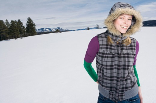Stock Photo: 1555R-314138 Woman wearing parka in snow