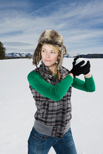 Woman holding snowball : Stock Photo
