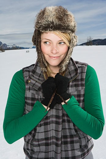 Stock Photo: 1555R-314150 Woman in winter attire looking away