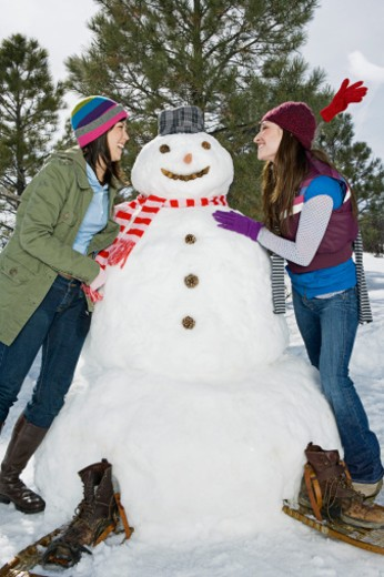 Women with snowman : Stock Photo