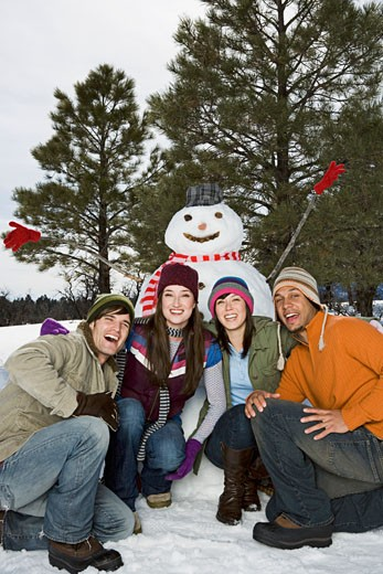 Stock Photo: 1555R-314189 Couples posing with snowman