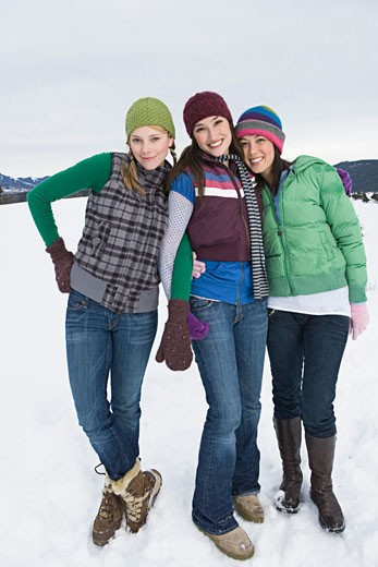 Portrait of friends in winter attire : Stock Photo
