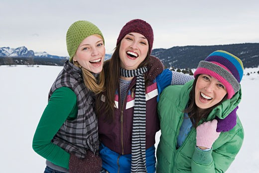 Laughing friends in winter attire : Stock Photo