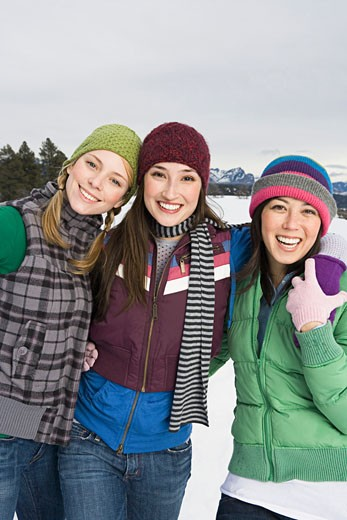 Friends in winter attire : Stock Photo