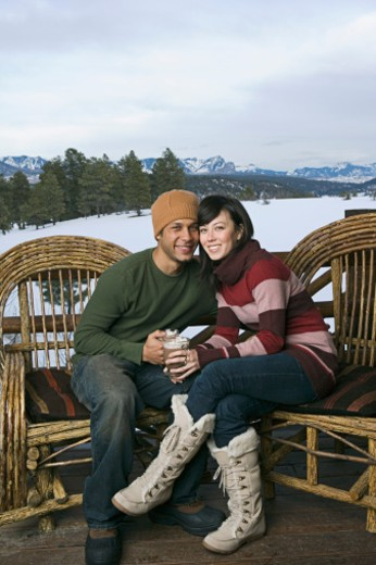 Couple drinking hot cocoa together on deck : Stock Photo