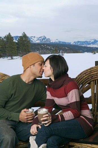 Couple kissing on deck : Stock Photo