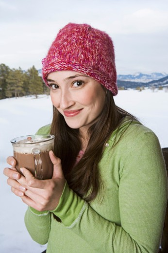Stock Photo: 1555R-314219 Woman holding cup of hot chocolate