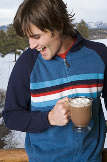 Man holding cup of hot cocoa : Stock Photo