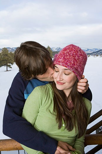 Stock Photo: 1555R-314231 Man kissing woman on cheek