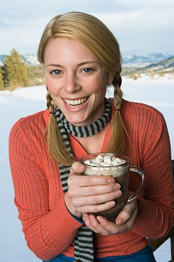 Stock Photo: 1555R-314243 Woman holding cup of hot cocoa