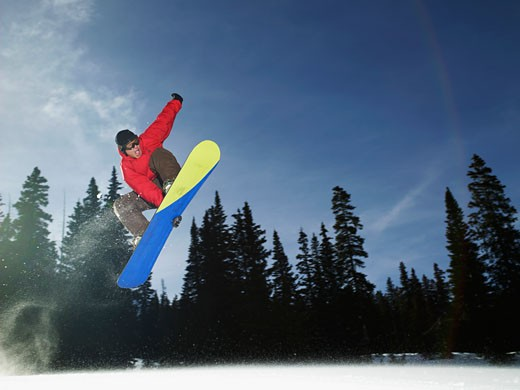 Stock Photo: 1555R-314250 Snowboarder in midair
