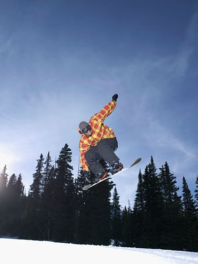 Stock Photo: 1555R-314251 Snowboarder in midair