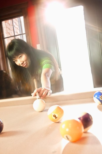 Woman playing pool : Stock Photo